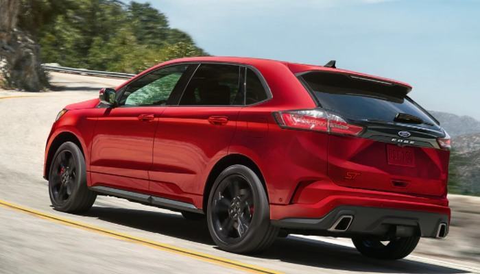 2021 Ford Edge driving down a winding road