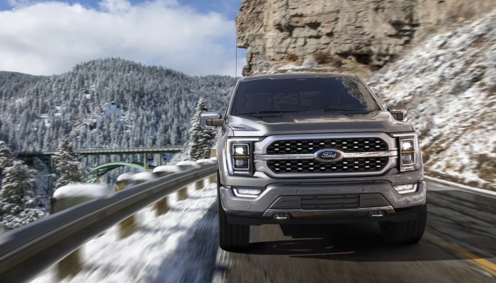 2021 Ford F-150 driving down a mountain road