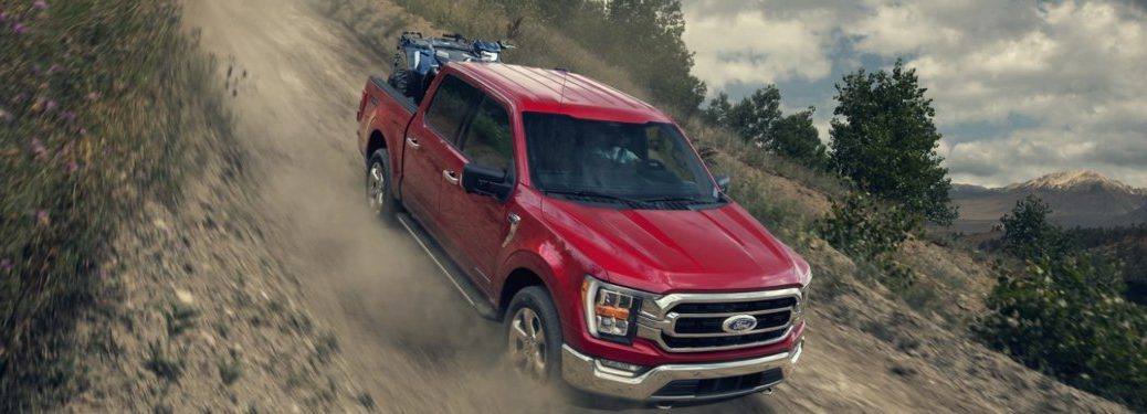 2021 Ford F-150 driving down a dirt incline
