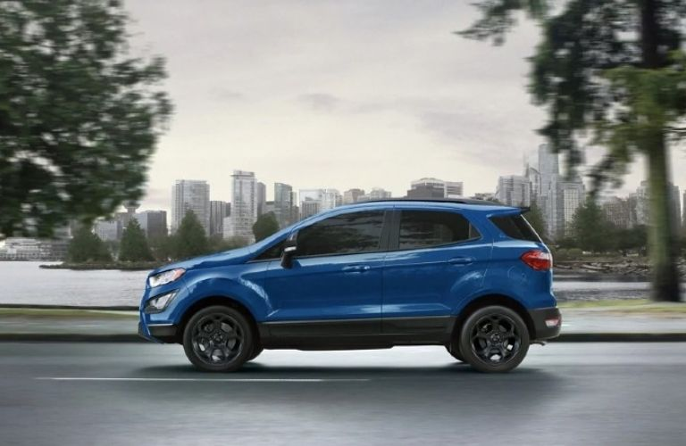 Side view of the 2021 Ford EcoSport in blue with a blurred background