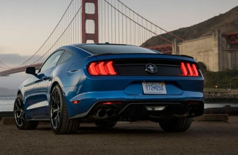 Rear view image of the 2022 Ford Mustang before a bridge