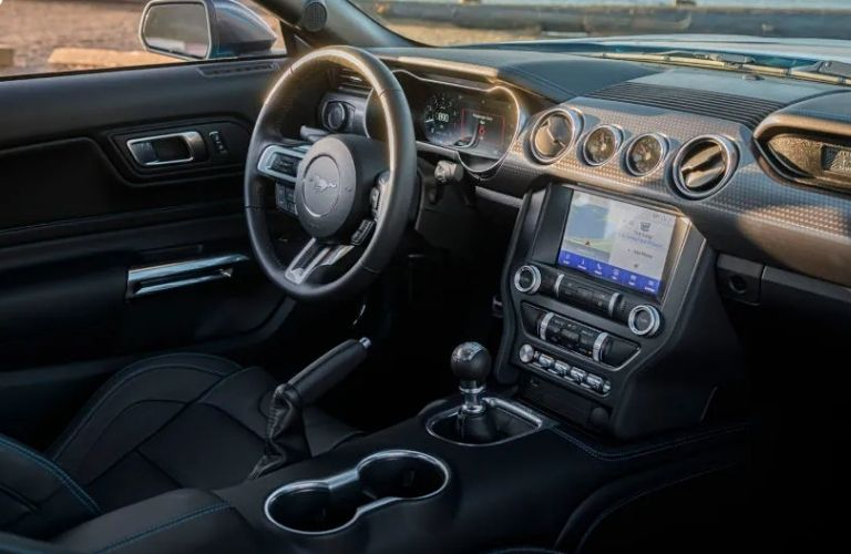 View of the steering wheel, infotainment system, and gear console of the 2022 Ford Mustang