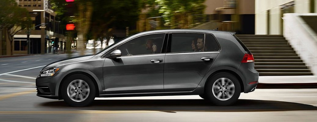 Profile view of 2019 Volkswagen Golf driving down city street