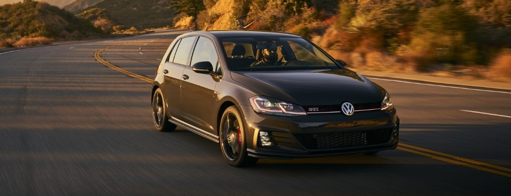 Front view of 2019 VW Golf GTI Rabbit edition driving on mountainous road