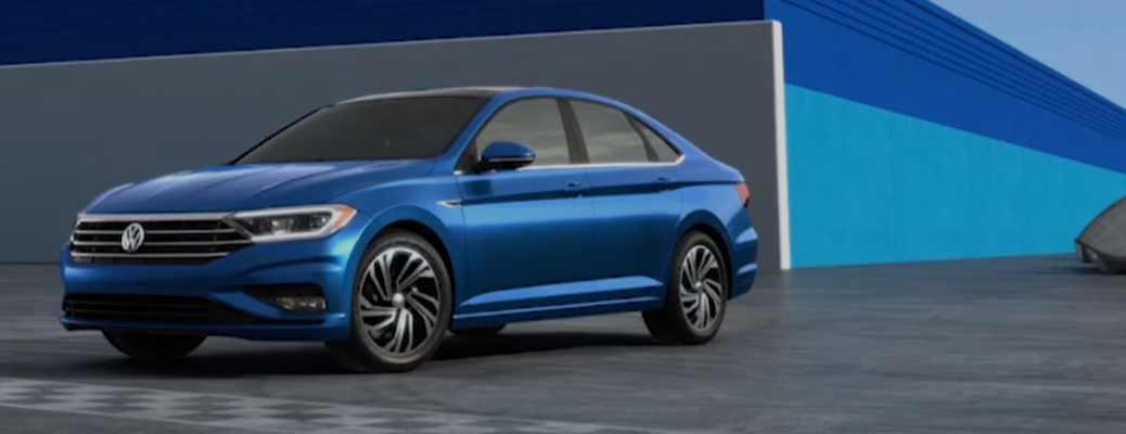 Blue 2019 Volkswagen Jetta parked in front of wall