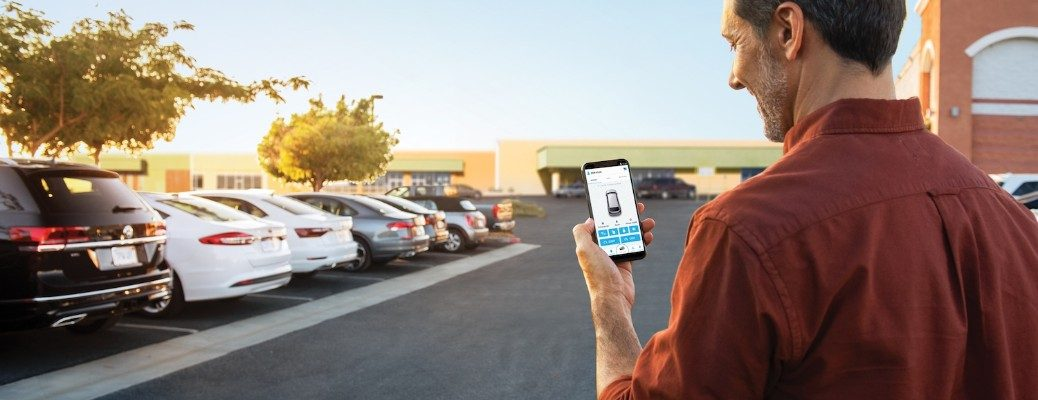 Man using VW Car-Net Remote Connect app to find car