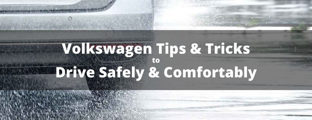 Volkswagen Tips & Tricks for Driving Safely & Comfortably banner against a close up of the rear of VW model driving in the rain