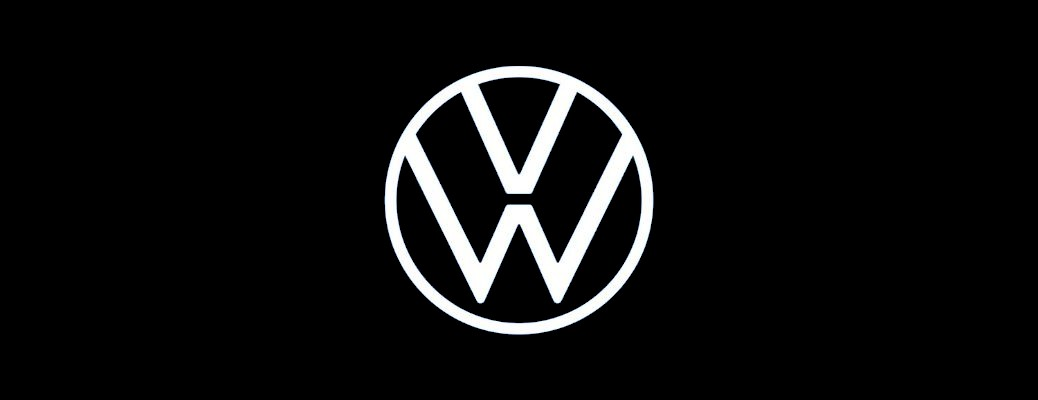 New white Volkwagen logo against a black background
