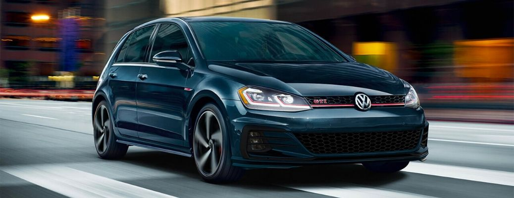 Exterior view of a teal 2020 Volkswagen Golf GTI