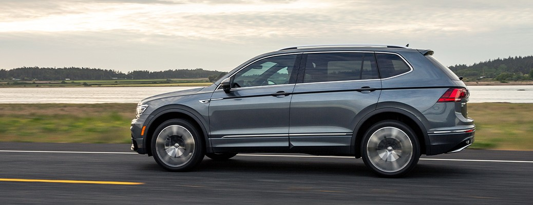 2020 Volkswagen Tiguan driving down a road near a body of water