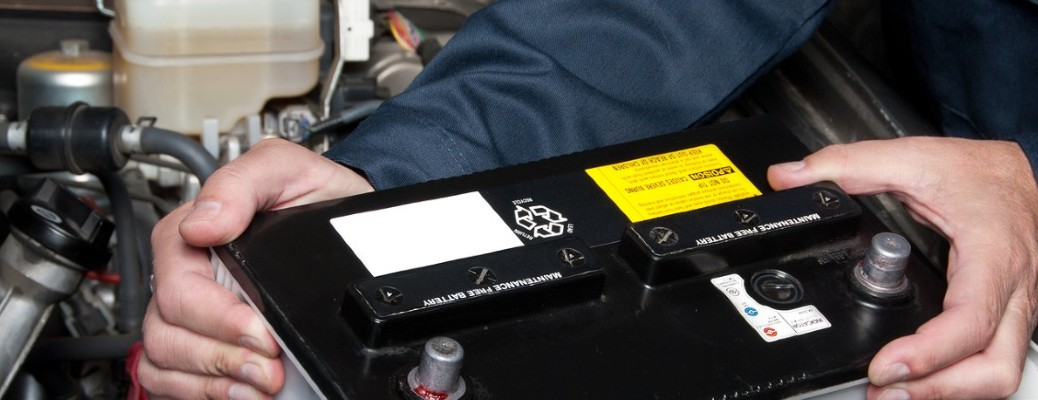 Car battery held by a person