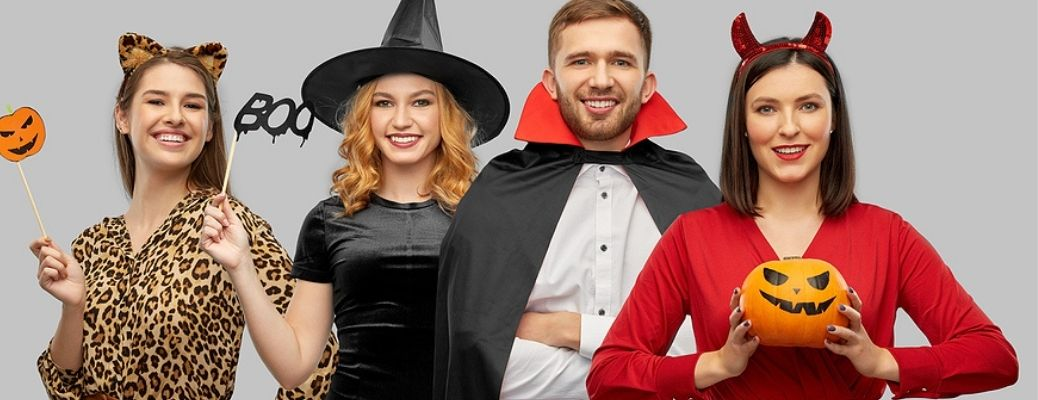 Three women and a man dressed up in Halloween costumes