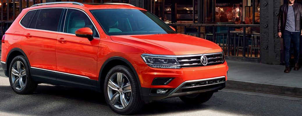 Orange 2019 VW Tiguan parked next to city curb