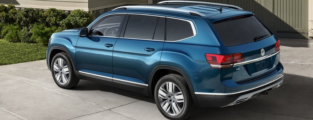 Profile view of blue 2019 VW Atlas in driveway