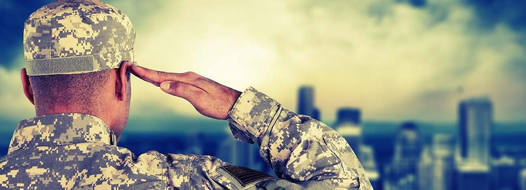 Soldier saluting in front of city skyline