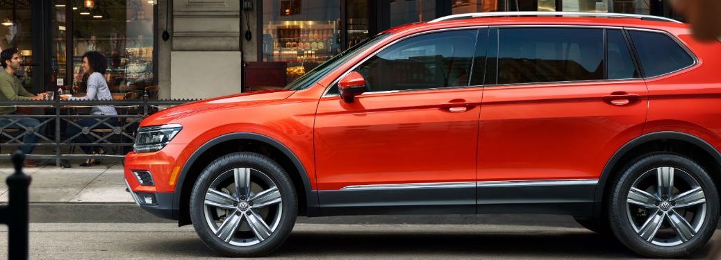 side view of an orange 2019 VW Tiguan