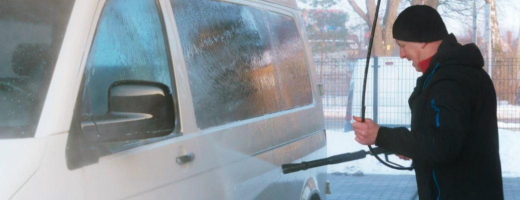 Van being washed with a pressure washer