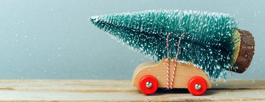 Toy car carrying a toy tree