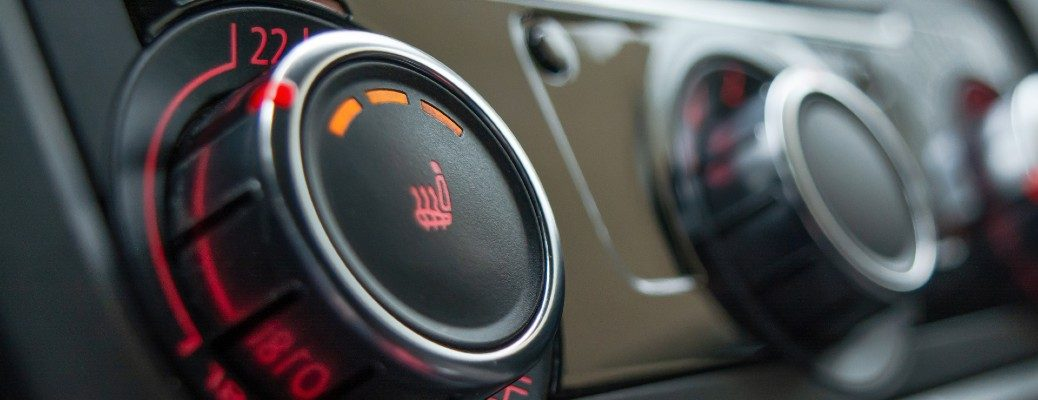 Heated seat button in an extreme close up