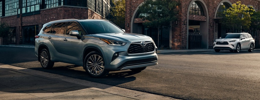 2021 Toyota Highlander parked on street with white Toyota Highlander in the background
