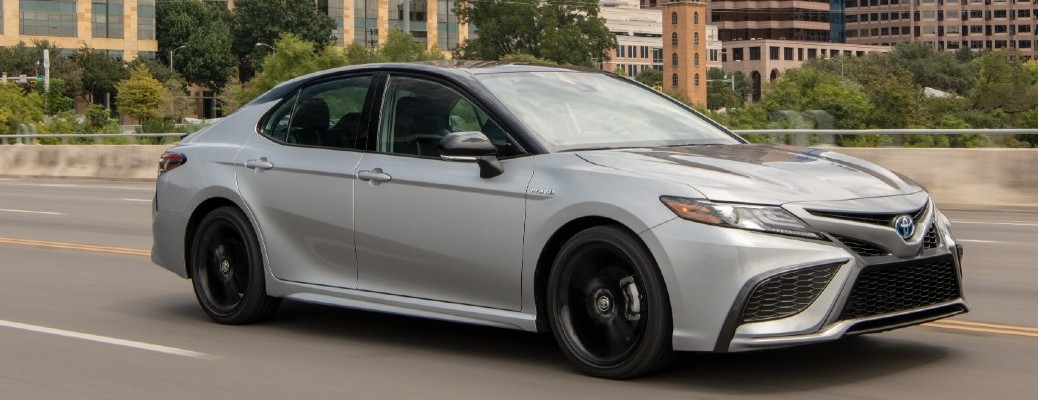 2021 Toyota Camry Hybrid driving down road