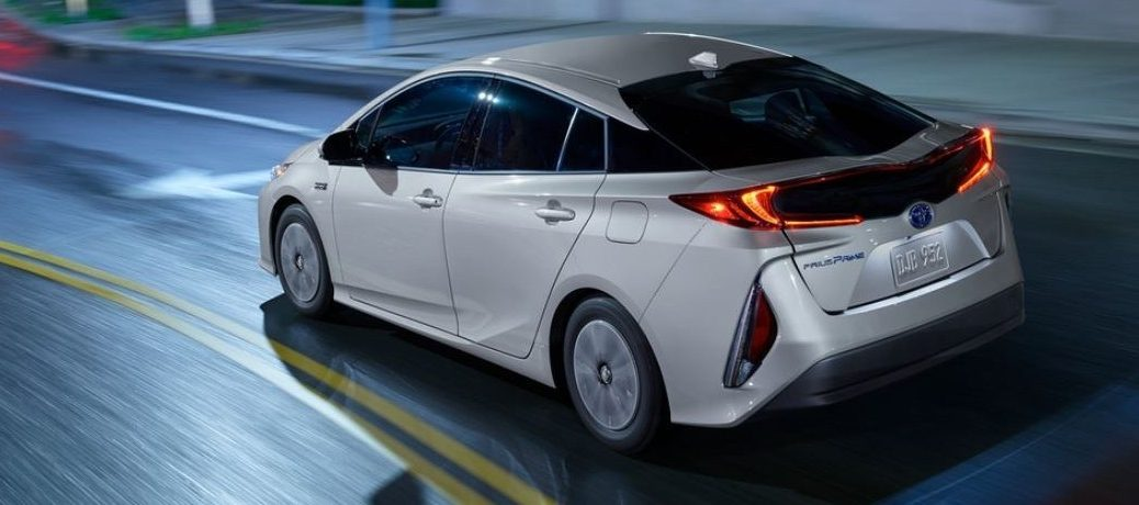 2021 Toyota Prius color white driving down street