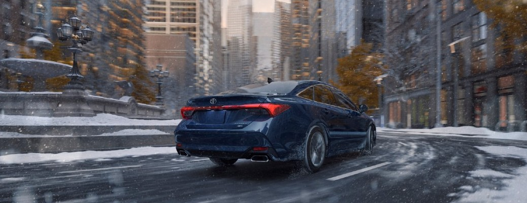 Rear view look at the 2021 Avalon driving through snow