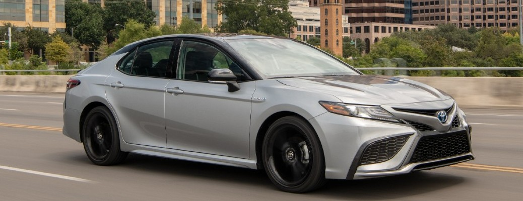 2021 Toyota Camry Hybrid driving on the road