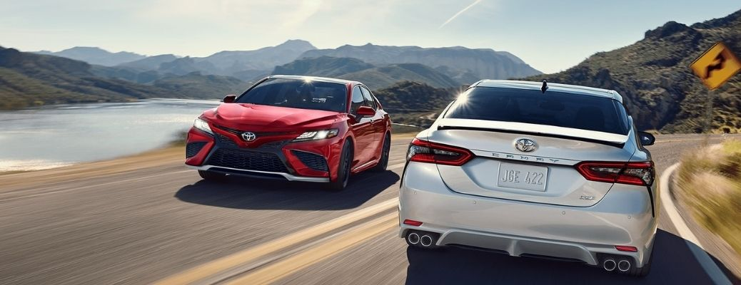 two 2021 Toyota Camry crossing each other in opposite directions