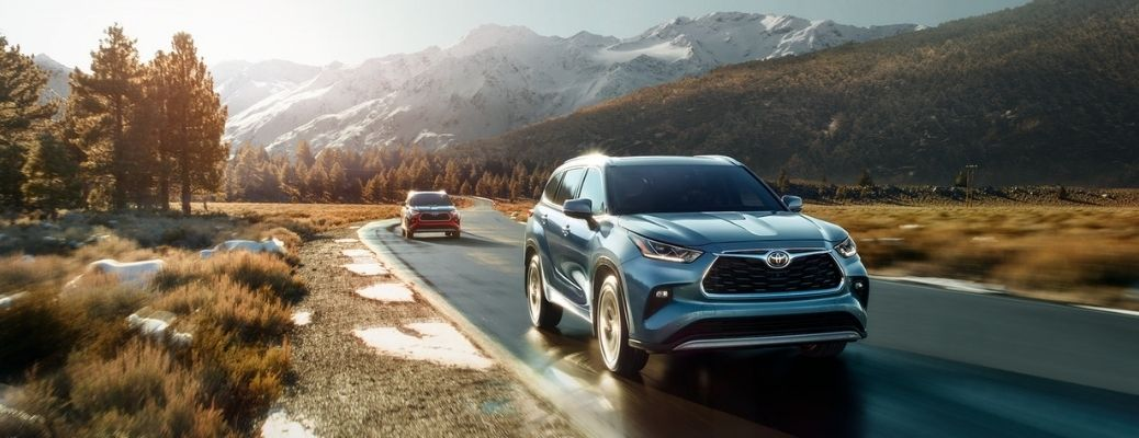 front view of the 2021 Toyota Highlander followed by another vehicle