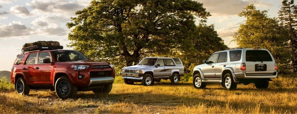 three 2021 Toyota 4Runner of different colors parked in a field