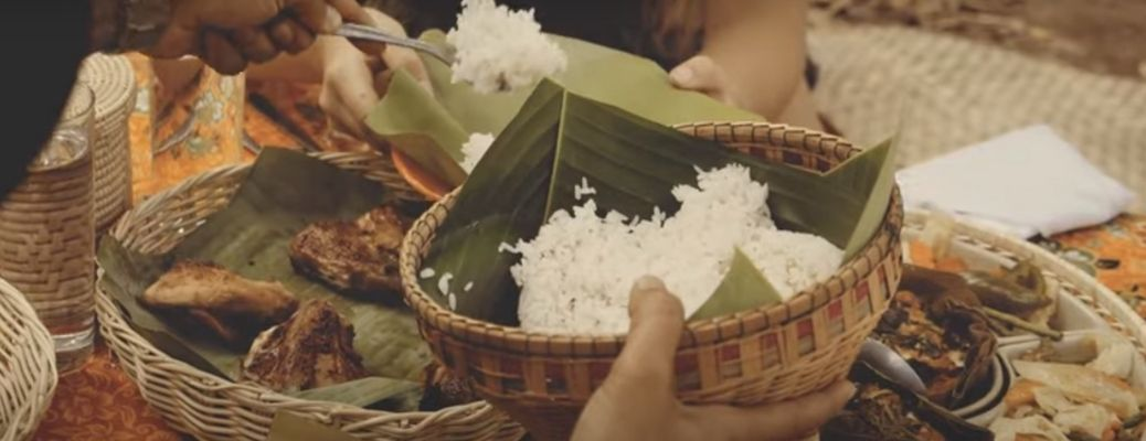 Image of a person serving rice