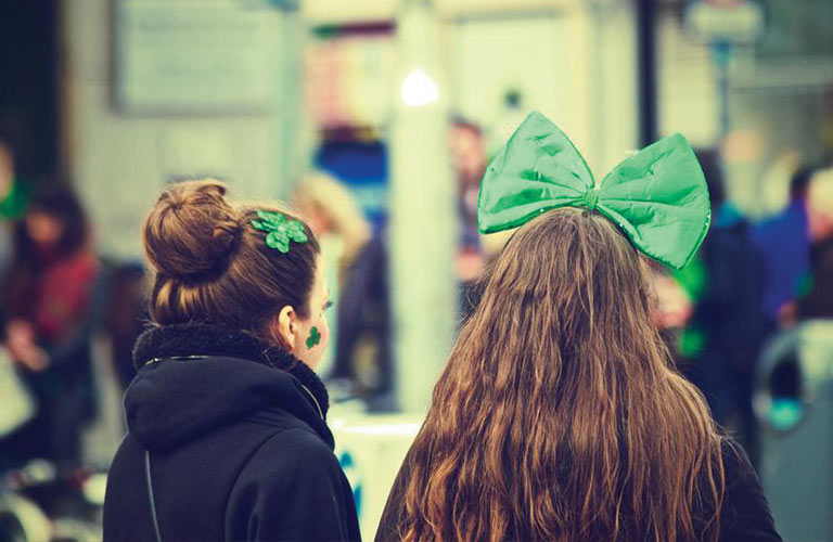women with green bows in their hair on St. Patrick's Day