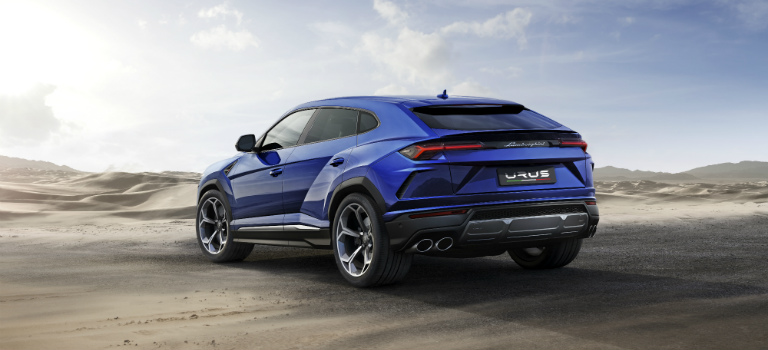 Lamborghini Urus blue in desert back view