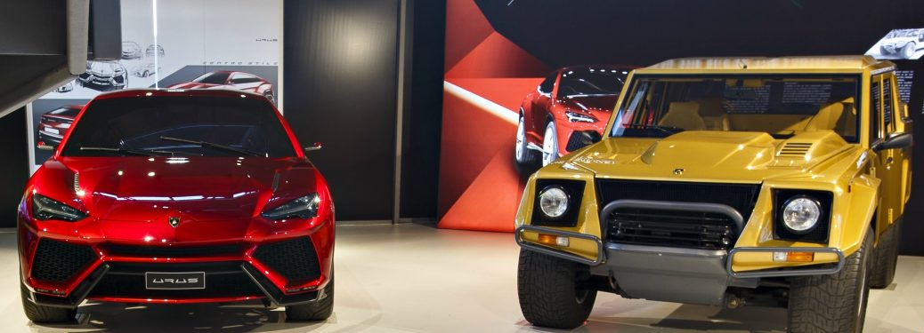 Lamborghini Urus red next to Lamborghini LM002 gold