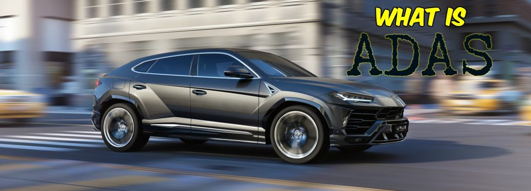 Lamborghini Urus black side view driving through the city with what is ADAS text