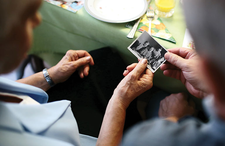 Man passing an old military image to another man