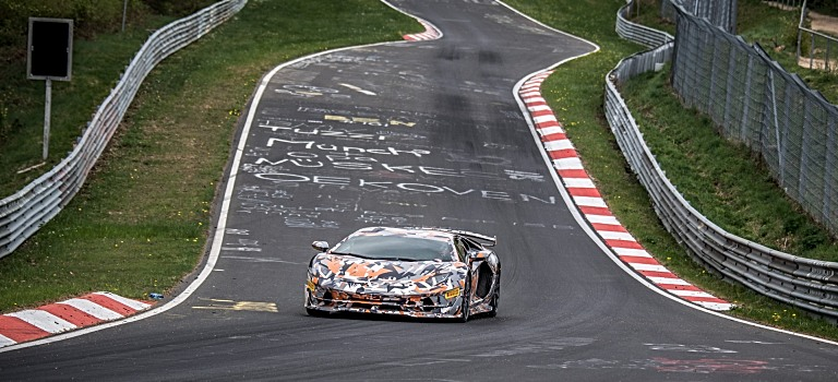 Lamborghini Aventador SVJ coming down through a series of turns at Nurburgring