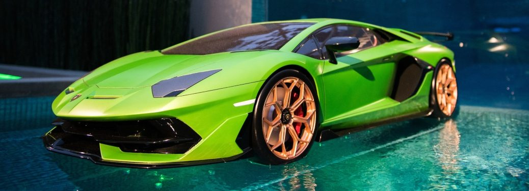 Lamborghini Aventador SVJ green on water side view
