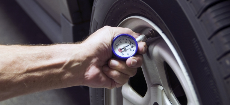 checking tire pressure on a tire