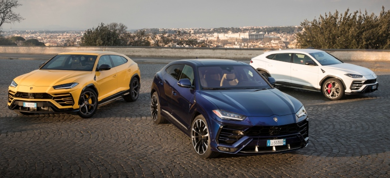 Lamborghini Urus yellow blue and white front and side views