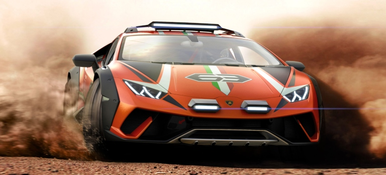 Lamborghini Huracan Sterrato orange front view sliding through the dirt