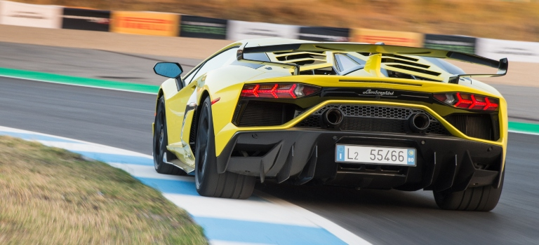 Lamborghini Aventador SVJ yellow back view on the track