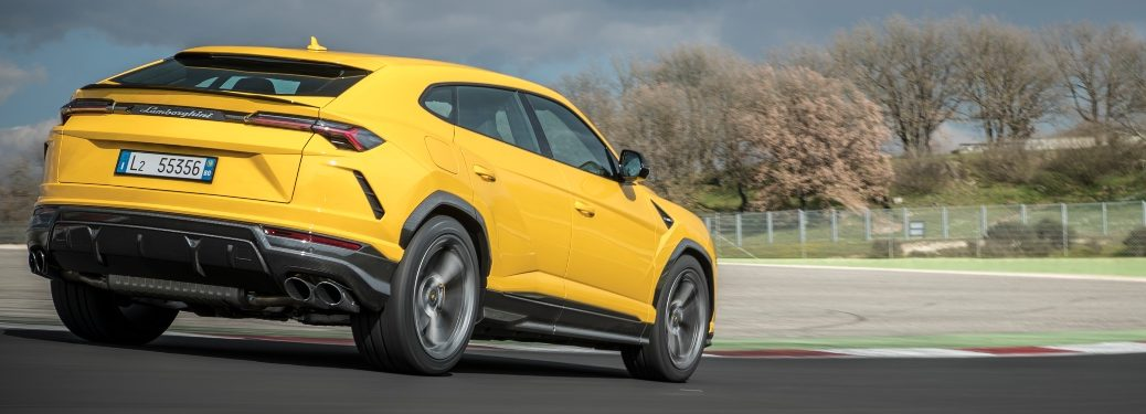 Lamborghini Urus yellow back view in fall