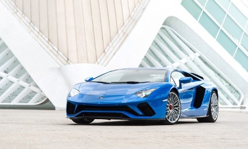 2020 Lamborghini Aventador blue painted parked in front of white building