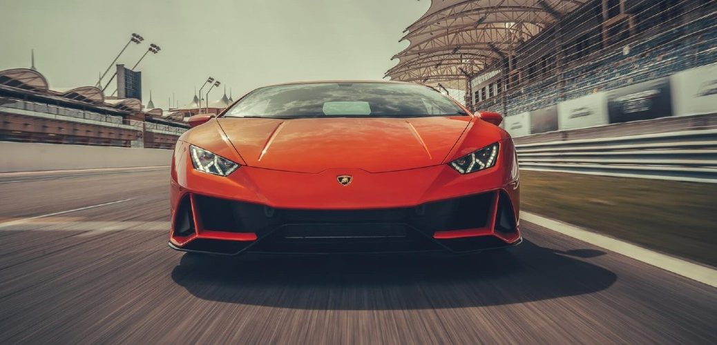 2019 Lamborghini Huracan Evo orange head on shot driving around race track