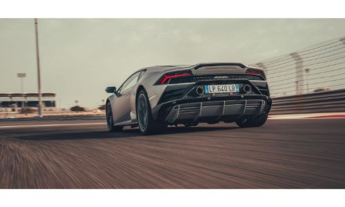 2019 Lamborghini Huracan Evo grey driving away from shot on a track