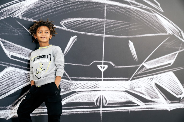 Kid in Lamborghini sweater on Lamborghini art