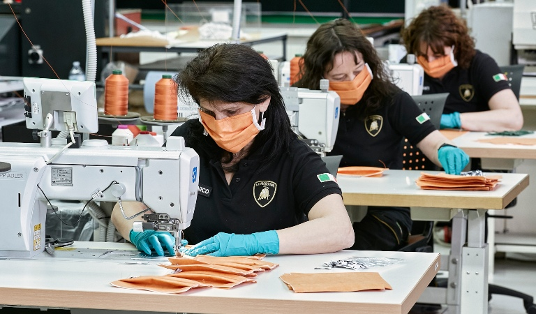 Lamborghini seamstresses making surgical masks