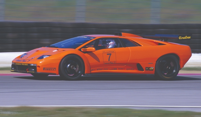 Lamborghini Diablo GTR orange side view on a track